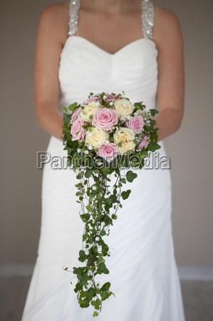 bride with large wedding bouquet