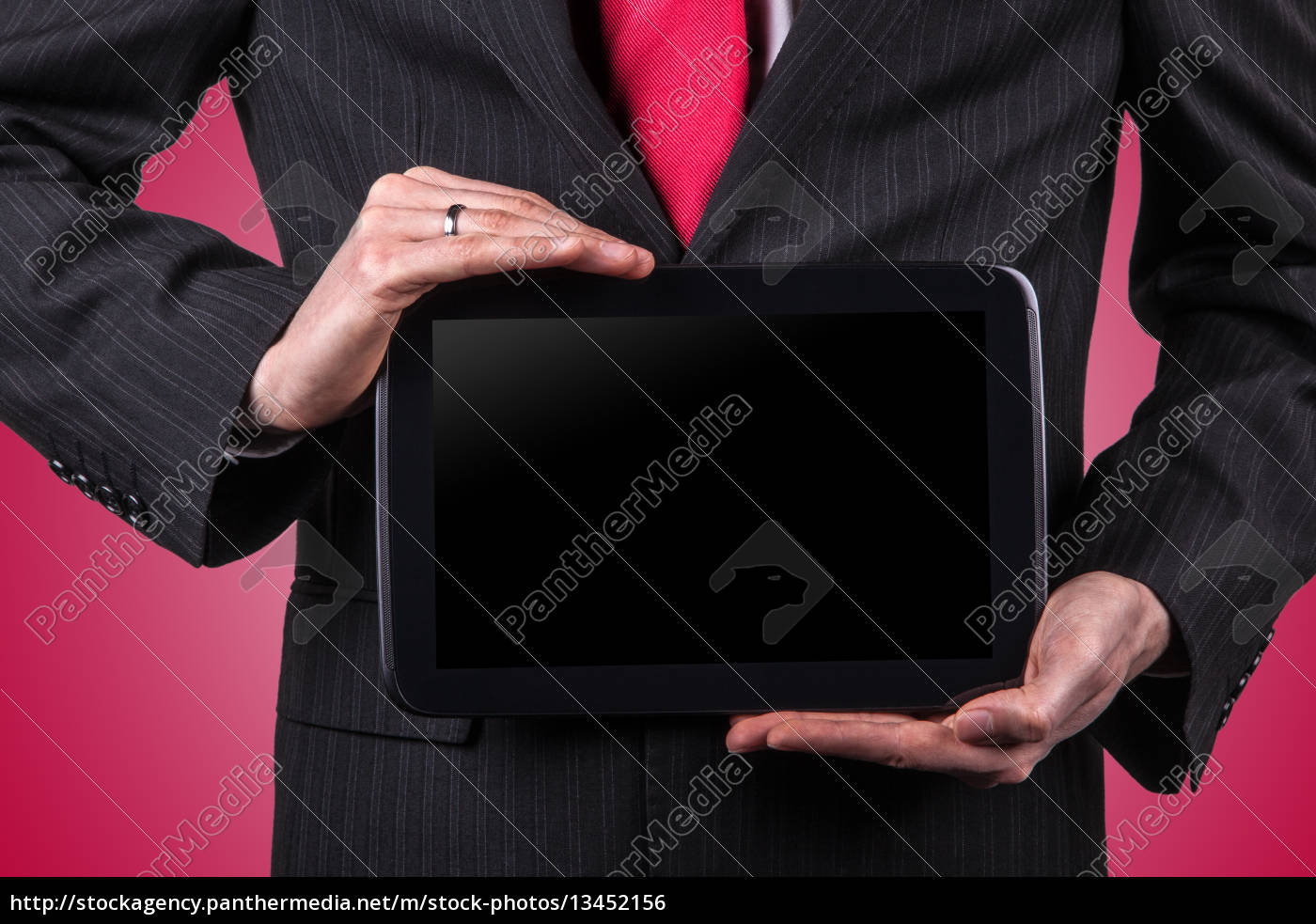 business, man, holding, a, tablet - 13452156