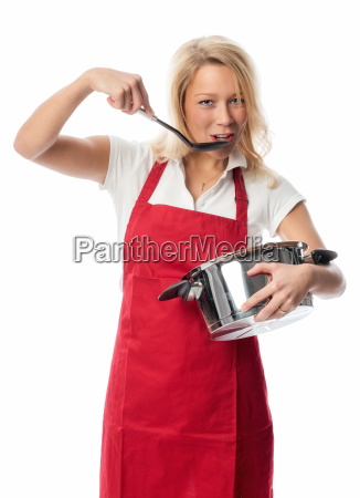 woman with apron holding a pot
