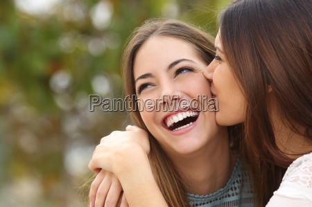 woman laughing with perfect teeth while