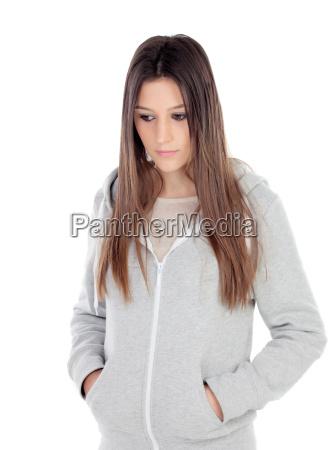 sad teenager girl with gray sweatshirt
