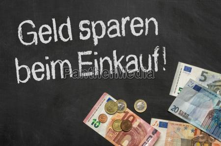blackboard with money save money