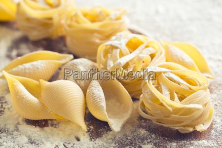 raw pasta and flour