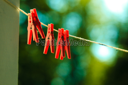 red clothes pegs on string outdoor