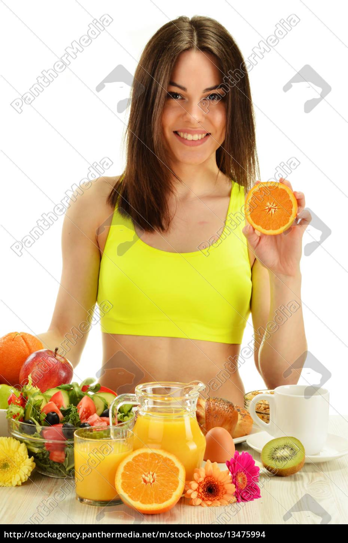 young, woman, having, breakfast., balanced, diet - 13475994