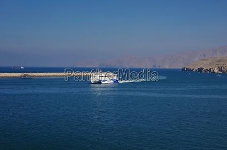 catamaran enters the harbor