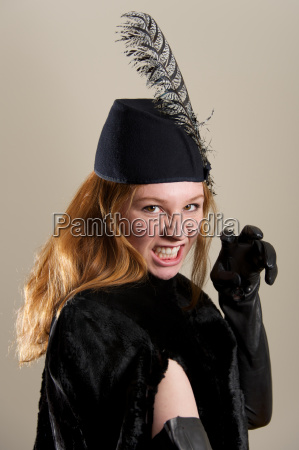 redhead in black hat pretending to