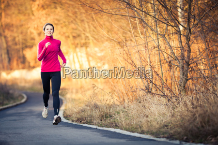 young, woman, running, outdoors, in, a - 13484678