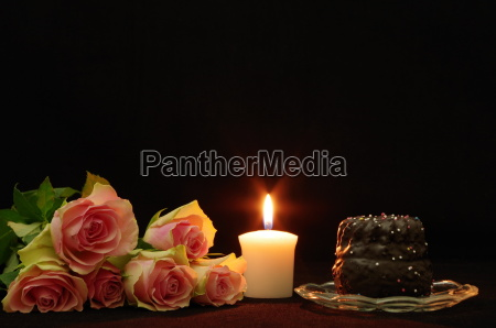 still life with roses candle and