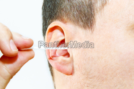 man with cotton swabs in ear