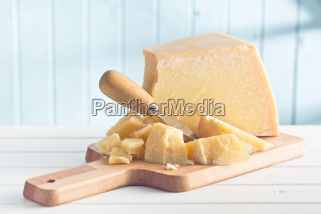 parmesan, cheese, on, cutting, board - 13494130