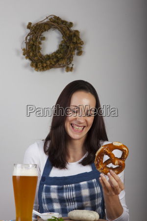 bavarian woman with a white sausage