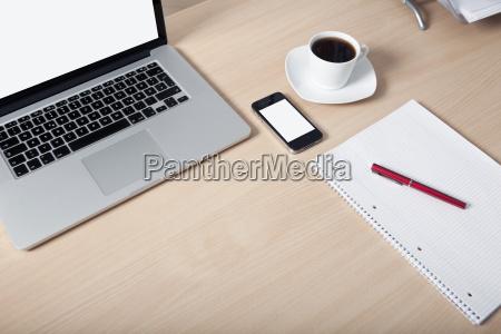 desk laptop mobile phone