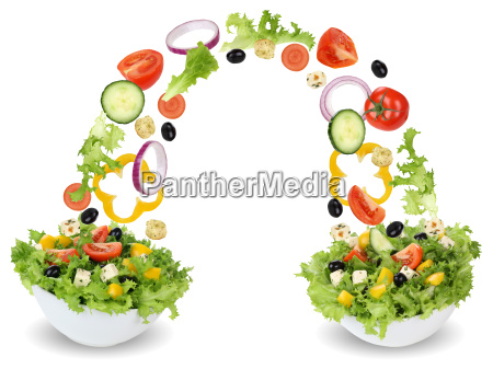 flying salad ingredients in bowl with