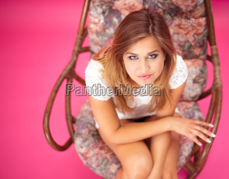 young female sitting in a chair