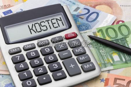 calculator with money bills cost