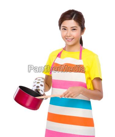 asian houswife cooking with saucepan
