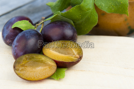 plums and plums with wooden board