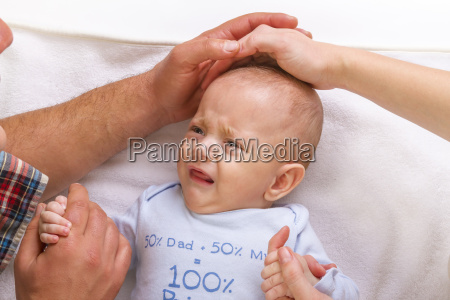 parents calm a crying baby