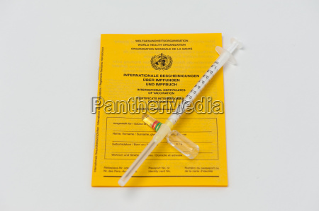 vaccination record with syringe and ampoule