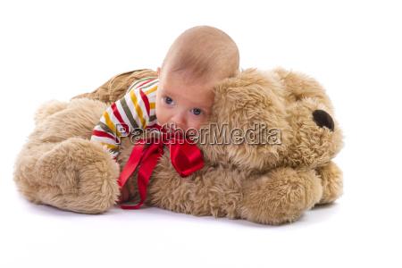baby, boy, over, plush, dog, on - 13523102