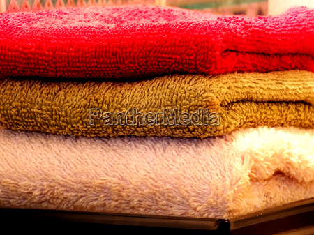 three colored fluffy towels