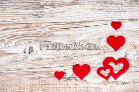 rustic wooden background with bright red