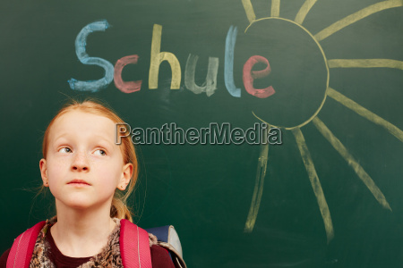 girl looks upwards on the board