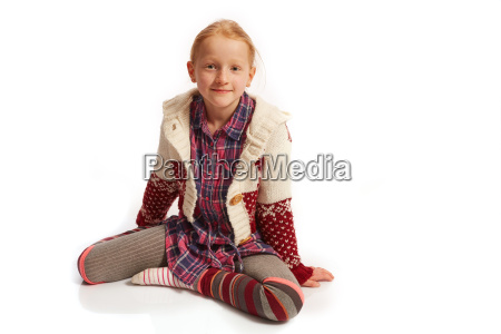 girl is sitting on the floor