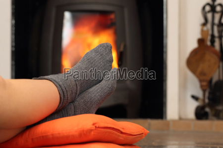 woman feet with socks resting near