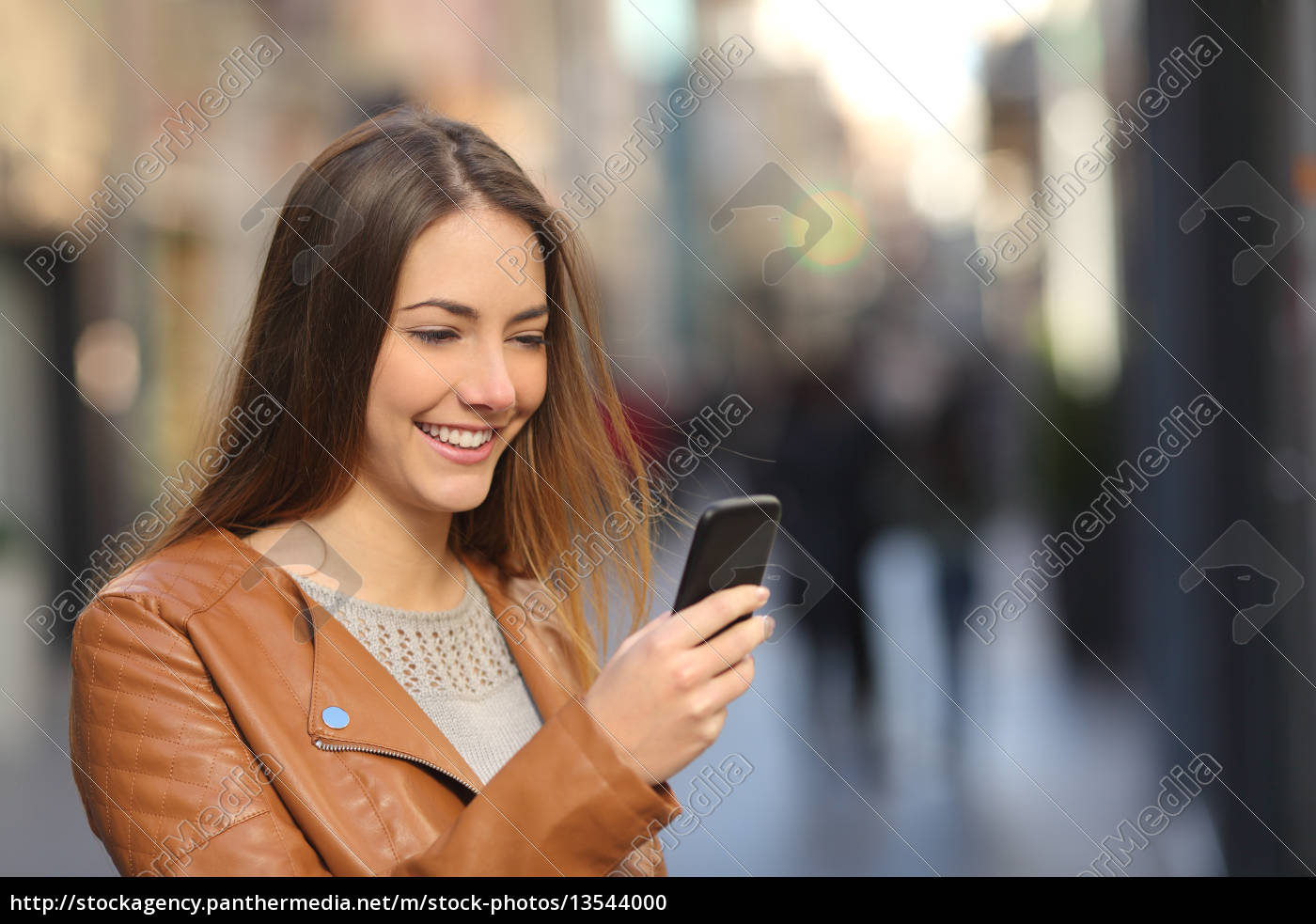 happy, woman, using, a, smart, phone - 13544000