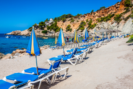 deck chairs over the beach in