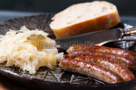 roast, sausages, with, sauerkraut, in, a - 13550018