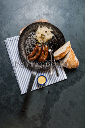 sausages, with, sauerkraut, in, a, pan - 13550010