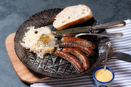 sausages, with, sauerkraut, in, a, pan - 13550020