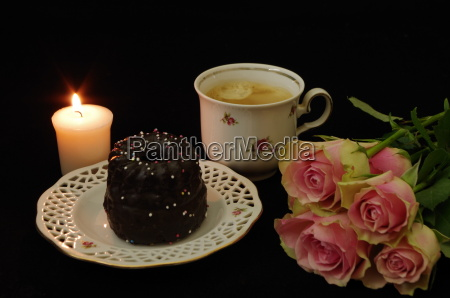 still life with cake candle roses