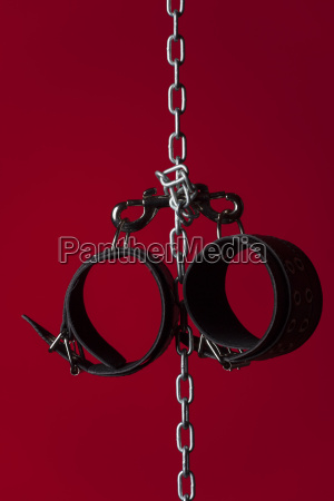 leather handcuffs on a chain