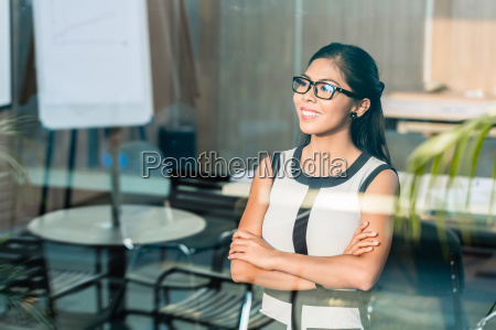 indonesian business woman at office window