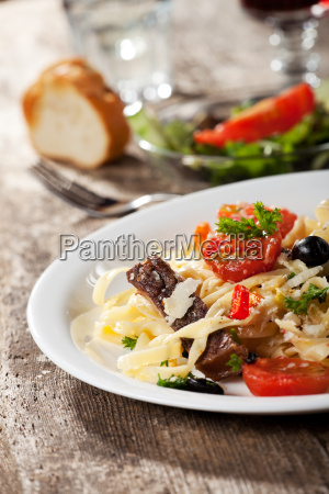 fresh pasta with tomatoes and olives