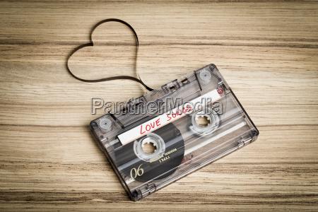 audio cassette tape on wooden backgound
