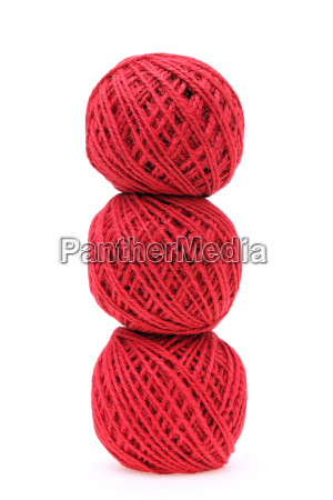 ball of red threads on white