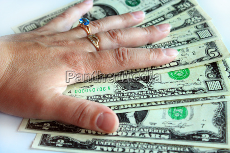 hand holding us dollars isolated on