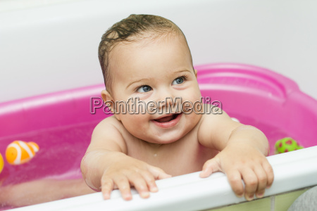 adorable baby bathing