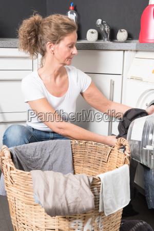 woman is charging washing machine