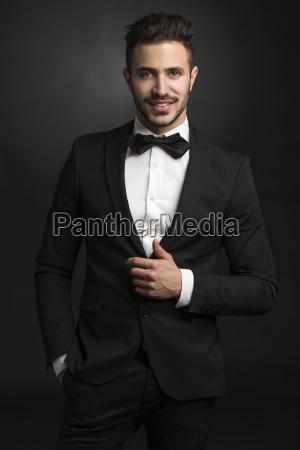 latin man wearing a tuxedo
