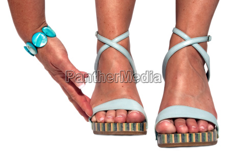 tanned hands and feet with light