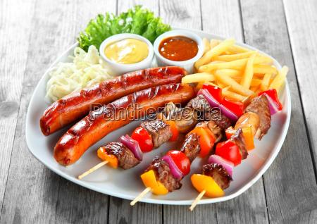 kebab sausage and fries on plate