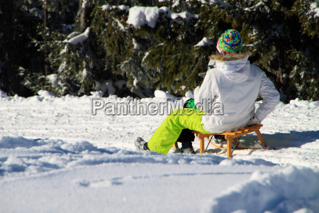 sleigh ride with mother and child