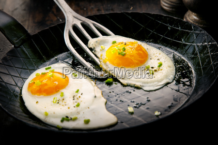 two free range fried eggs seasoned