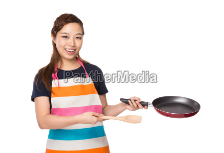 housewife hold with pan and wooden